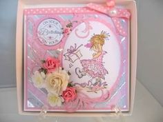 A few strips of pretty paper and some silver gilding flakes and you can have this lovely effect on your own projects