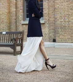 The flouncy white skirt, long navy blazer and minimal black sandals make for quite the chic look!