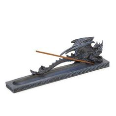A finely detailed dragon defends its home atop a Celtic-inspired base, designed to collect the singed remnants of the past. Infuse your home with the mystical scent of your choosing as this magnificent beast watches over the lighted stick.