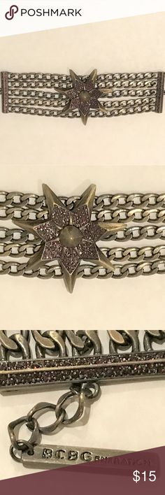 """BCBGeneration Antique Gold &Amethyst Star Bracelet This is a 2-1/2"""" antique brass 7-point star with amethyst crystal points and brass cone center. It hangs from the middle of the 5 thick chains. The ends also have amethyst crystal edges. It fits 7-1/2 to 8-1/2"""" long. BCBGeneration Jewelry Bracelets"""