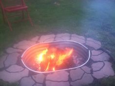 DIY Fire Pit - $50! Two 37x16x12 Straight window wells ($9.99/each) screwed together makes a great oval ring; Nine 8x16 pavers ($0.69/each) for fire ring to sit level on; 10-12 Flagstone pavers ($1.24/each) to decorate the edges; One 15lbs bag pebblestone gravel ($1.69/bag) to fill the inside of the pit; nuts, bolts & washers (les than $4 for the wells).