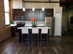Carriage House Loft Apartments For Rent - Chicago Chicago Lofts, Chicago Apartment, White Quartz Counter, Open Concept Floor Plans, Exposed Brick Walls, Carriage House, City Living, Large Windows, Storage Spaces