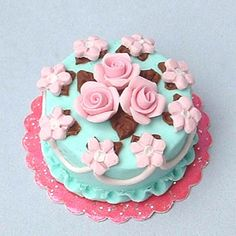 Pink roses on turqoise cake - dollhouse miniature by Blue Kitty Miniatures