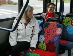 Looks like yarn-bombing on a bus. I would be smiling too. :)
