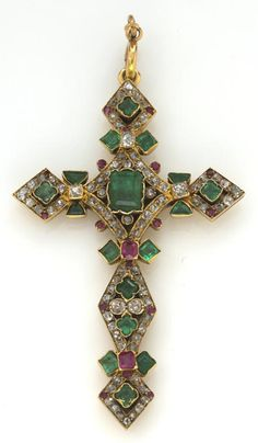 An emerald, ruby and diamond cruciform pendant  estimated total diamond weight: 1.00 carat; mounted in eighteen karat gold; dimensions: 2 3/8 x 1 7/16in.