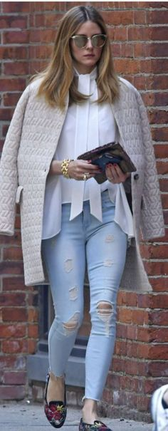 Who made Olivia Palermo's white tie top, sunglasses, blue ripped skinny jeans, tan coat, and floral black loafers?