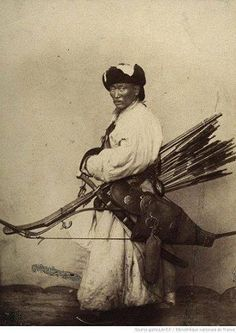Mongolian warrior in full gear. Anonymous photographer. Circa 1900.
