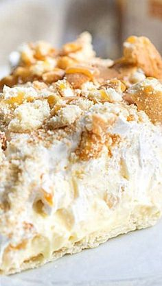 Best Ever Banana Pudding Pie ~ It is not a pudding pie in the traditional sense. It is more a mixture of flaky pie crust, vanilla pudding, cool whip, vanilla wafers, and sliced bananas.