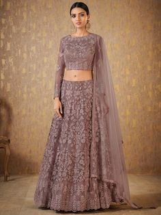 Look ravishing as you don this atypical mauve designer lehenga choli set featuring self color resham accentuation all over the set with stone detailing for a subtle yet blingy appeal! This lehenga choli set is accompanied with matching net dupatta. Indian Fashion Dresses, Indian Bridal Outfits, Indian Gowns Dresses, Dress Indian Style, Indian Designer Outfits, Bridal Dresses, Indian Lehenga, Lehenga Choli, Net Lehenga