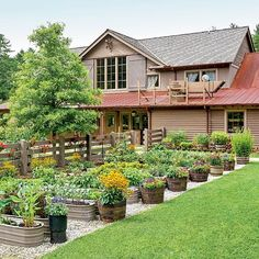 Behind the Canyon Kitchen restaurant garden in Cashiers, NC via Southern Living--galvanized fish tubs and whiskey barrels