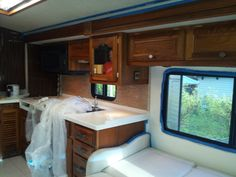 Motorhome - just finished installing the tiles for the backsplash - wall over couch painted and drying