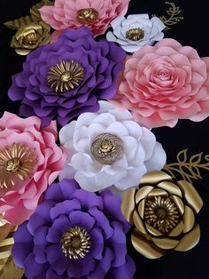 these beautiful handmade paper flower backdrop is perfect for party and home decor. These paper flowers are made out of 65lb cardstock in any color, they where made to last years. This listing is for 9 flowers, 3 large flowers that measure 16-18 inches in diameter, 3 medium that