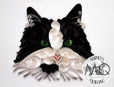 A custom quilled cat portrait of a black and white cat made by artist Stacy Bettencourt, owner of Mainely Quilling in Jefferson, Maine.