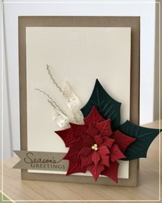 handmade Christmas card ... Spellbinder's poinsettia die ... luv the stylish look of this card ... burgundy flower with black leaves ... lacy ribbon and spiral tendrils ... lots of white space ... kraft label and base card ... elegant!!!