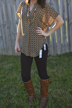 I like the pattern and the longer length of this shirt.  And it has sleeves! Great for spring, summer and fall. -E