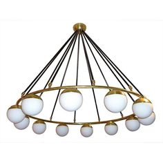Impressive Italian Twelve Lights Chandelier in the style of Stilnovo | From a unique collection of antique and modern chandeliers and pendants at https://www.1stdibs.com/furniture/lighting/chandeliers-pendant-lights/