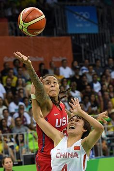 USA's forward Seimone Augustus and China's guard Zhao Zhifang go for the ball…