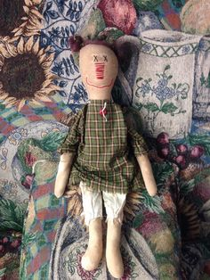 Cute primitive rag doll ready for her new home! Shes about 19 inches tall. Made from muslin that Ive aged. Wearing her primitive dress with