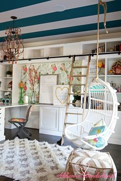 A chic, colorful and happy home office like no other!  Fun and whimsical details around every corner including a hanging chair swing, teal striped ceiling, rolling library ladder and much more!  Fun accessories from HomeGoods!  Sponsored by HomeGoods.