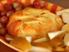 Easy Baked Brie: Roll out refrigerated crescent roll dough, spread with fruit preserves.  Wrap around brie and crimp.  Bake at 375 for 15 minutes.