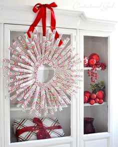 Gift wrap wreath - actually sounds easy!  Just rolled, taped pieces of wrapping paper glued to a wreath form.