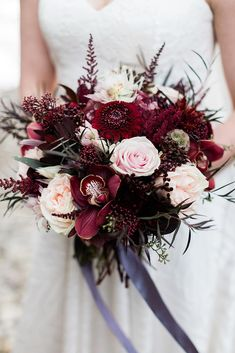 beautiful wedding bouquets with burgundy dahlias orchods and gentle pink roses nicole sarah photography via instagram