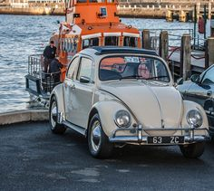 Old VW Beetle In Front Of Dun Laoghaire Lifeboat