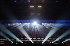 Empty tribune with spotlights in arena by Urs Siedentop