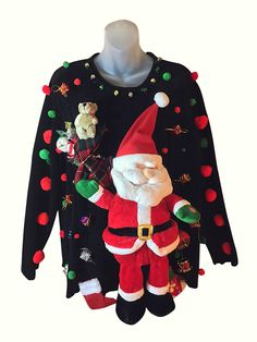 This amazing custom Christmas sweater features a big, thick, plush Santa Claus doll that sings and talks when you press the button! Just above his right hand is a hand-made toy sack filled with a few toys.  Material: 100% Acrylic  Size: 2X 52 width x 26 length  –Click Here Sizing Chart And Measurements Information  Condition: Very Good