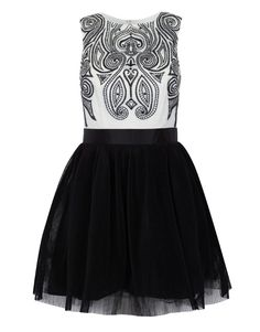 Adore the complimentary contrast between the high neck embroidered top and full-volume skirt of this Lipsy VIP dress. Also, monochrome will never date. Available at lipsy.co.uk