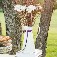This enamel Pitcher feels perfectly aged and is well suited for weddings and receptions with a vintage chic theme. Use as a container for wild flowers or herbs to create simple and casual centerpieces. Pair with the French Provençal Mini Decorative Pitcher favors to complete the look. Meant for decorative use only. Available for purchase online at http://madelinesweddings.weddingstar.com/product/french-provencal-style-enamel-pitcher