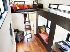 Dramatic tiny house. Love how the black frames in the white and the wood.