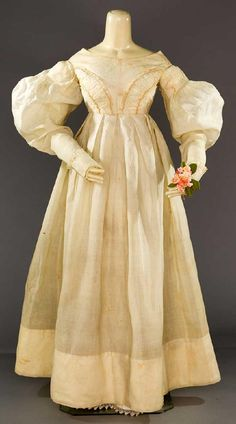 Lot: WHITE ORGANDY EMPIRE GOWN, LATE 1830s, Lot Number: 0196, Starting Bid: $300, Auctioneer: Augusta Auctions, Auction: COUTURE, HISTORIC & VINTAGE CLOTHING AUCTION, Date: May 9th, 2017 CEST
