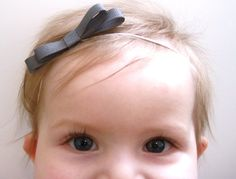 Small Bow Headband in Grey,Pink,White,Teal Back,or Light Brown Bow Baby Headband- Choose size. $6.00, via Etsy.