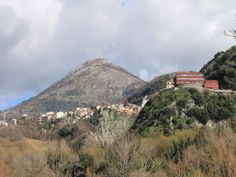 Mount Serra Rotonda; next a glimpse of the town hall behind the red scolastic building and, at the ravine left side, among houses, there is... mine too! :-)