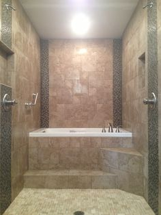 Walk Through Dual Head Shower To A Raised Drop In Jacuzzi Whirlpool Tub.  All Porcelain Tile With Glass And Natural Stone Mosaic Accent.