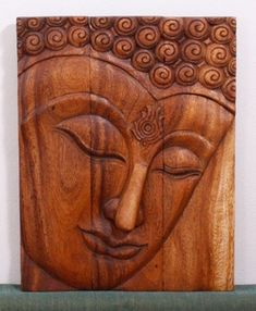 #Buddha #Wall #Decor hand carved wood panel.    The Ushnisha is a three dimensional oval at the top of the head of the Buddha. It symbolizes his wisdom and openness as an enlightened being. The first representations of the Buddha in the 1st century CE in the Greco-Buddhist art of Gandhara also represent him with a topknot, rather than just a cranial knob. It is thought that the interpretation of the ushnisha as a supernatural cranial protuberance happened at a later date, as the…
