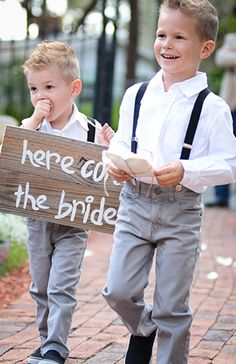 Ring bearers, grey suits, suspenders and the wooden sign all feel give off the lowcountry feel. These kids are too cute!