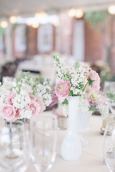 Beautiful, simple wedding table centerpieces. | Photo by Astrid Photography