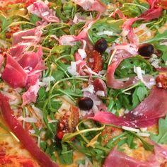 Prosciutto Arugula Pizza w/ Homemade Tomato Sauce...............Mozzarella Cheese, Prosciutto, Sun Dried Tomatoes, Topped with Fresh Arugula & Shaved Parmesan Cheese