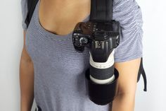 """clip lets you """"holster"""" your dslr to a belt or a backpack strap or just about anything else - quick draw feature, as well."""