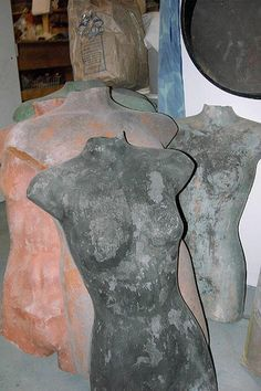 hypertufa body.  I just bought one of these dress forms at Goodwill - anxious to do this!