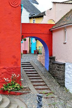 Steps, arches, bright colors are everywhere in this hilly little village Wales Uk, North Wales, Wales Holiday, England Ireland, Snowdonia, British Isles, Great Britain, Cool Places To Visit, Places Ive Been