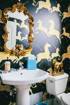 This Scalamandré zebra wallpaper is so classic.