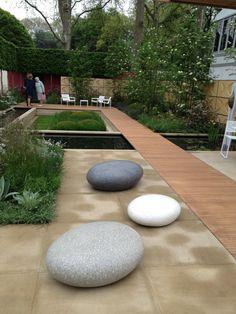 Rupert Myers garden Chelsea flower show  Love the #large polished rocks as garden / patio decor items