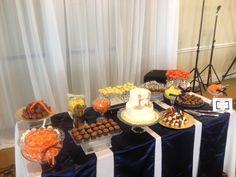 orange and yellow wedding dessert bar