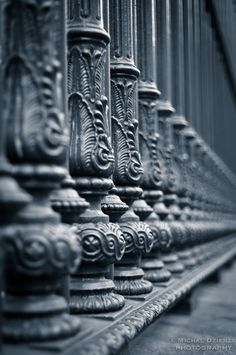 Classic shallow depth of field railings shot:  Railings by Michal Dzierza, via 500px