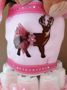 Handmade onesie to coordinate with pink camo tutu. Deer applique with matching camo tutu with flower detail. Onesie is size 12 mo.