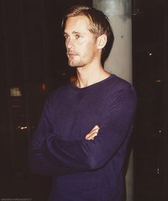 Alexander Skarsgard in a navy shirt