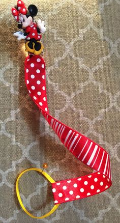 Let Minnie Mouse keep track of your lil ones pacifier on Red and White ribbon double sided..(lead /nickle free metal clip)  by BabyBirdCollection